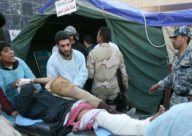 PHOTO: MOHAMMED SAWAF/AFP/Getty Images. Iraqi paramedics wheel an injured man into Karbala hospital emergency room after the deadly bombing in Karbala.