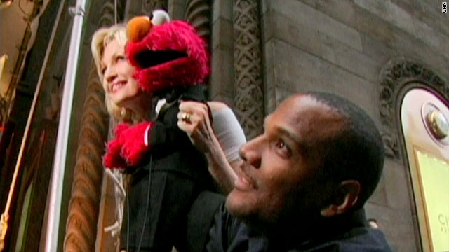 Gotta Watch: Being Elmo; meet the mob; rig jumps median
