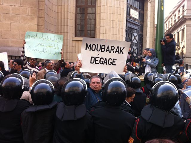 Photo: Ben Wedeman/CNN. One protestor in Cairo holds up a sign in French saying 'Mubarak, Leave,' a slogan seen regularly during the Tunisia revolution ahead of the overthrow of President Ben Ali.