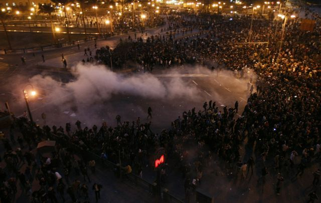 Photo: Mohammed Abed/AFP/Getty Images. Riot police fired tear gas at anti-government protestors in Cairo who, inspired by the recent revolution in Tunisia, are demanding the resignation of their president.