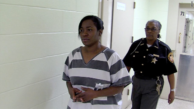 Kelley Williams-Bolar is escorted through the Summit County, Ohio, jail last week.