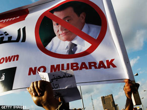 Protestors hold an anti Hosni Mubarek sign in Tahrir Square during afternoon anti-government protests today in Cairo.