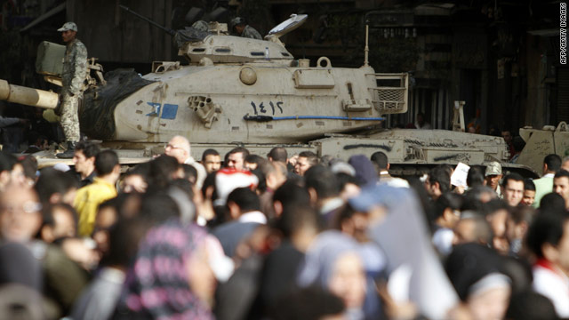 Egyptian demonstrators gather in Cairo's Tahrir Square close to a military tank on Monday.