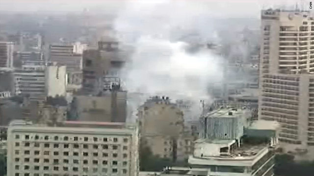 Smoke or tear gas is seen rising near the north entrance to Cairo's Tahrir Square on Wednesday.