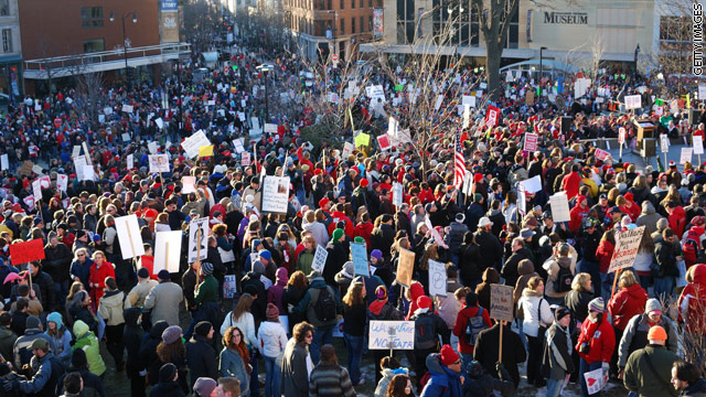 Tea Party activists join protests, favoring Wisconsin budget bill