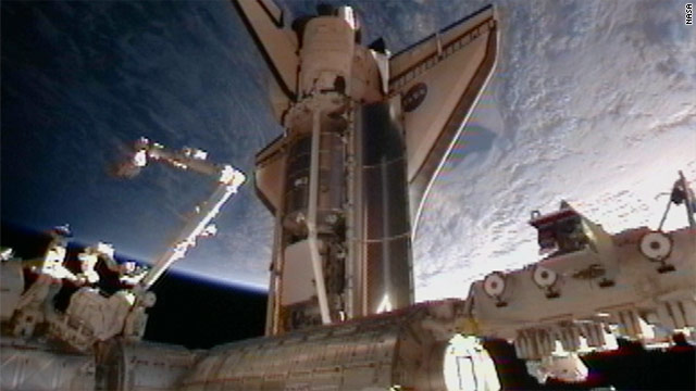 Shuttle Discovery docks with space station for 13th and final time