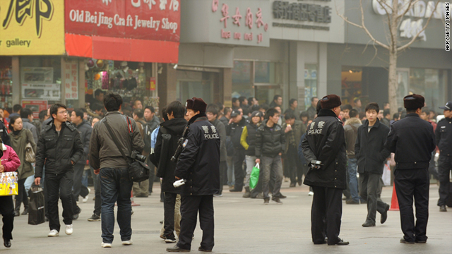 Security forces flood Beijing before protests