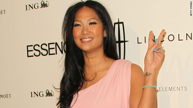 kimora lee simmons 2011 pictures. Kimora Lee Simmons reaches out