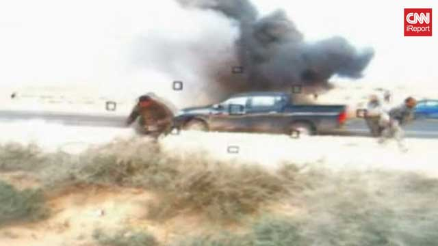 Gotta Watch: Libya under fire; John Oliver gets serious; police car smashed