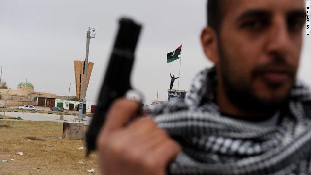 Opposition: Violence rages despite Libyan claim of cease-fire T1larg.libya.gun.gi.afp