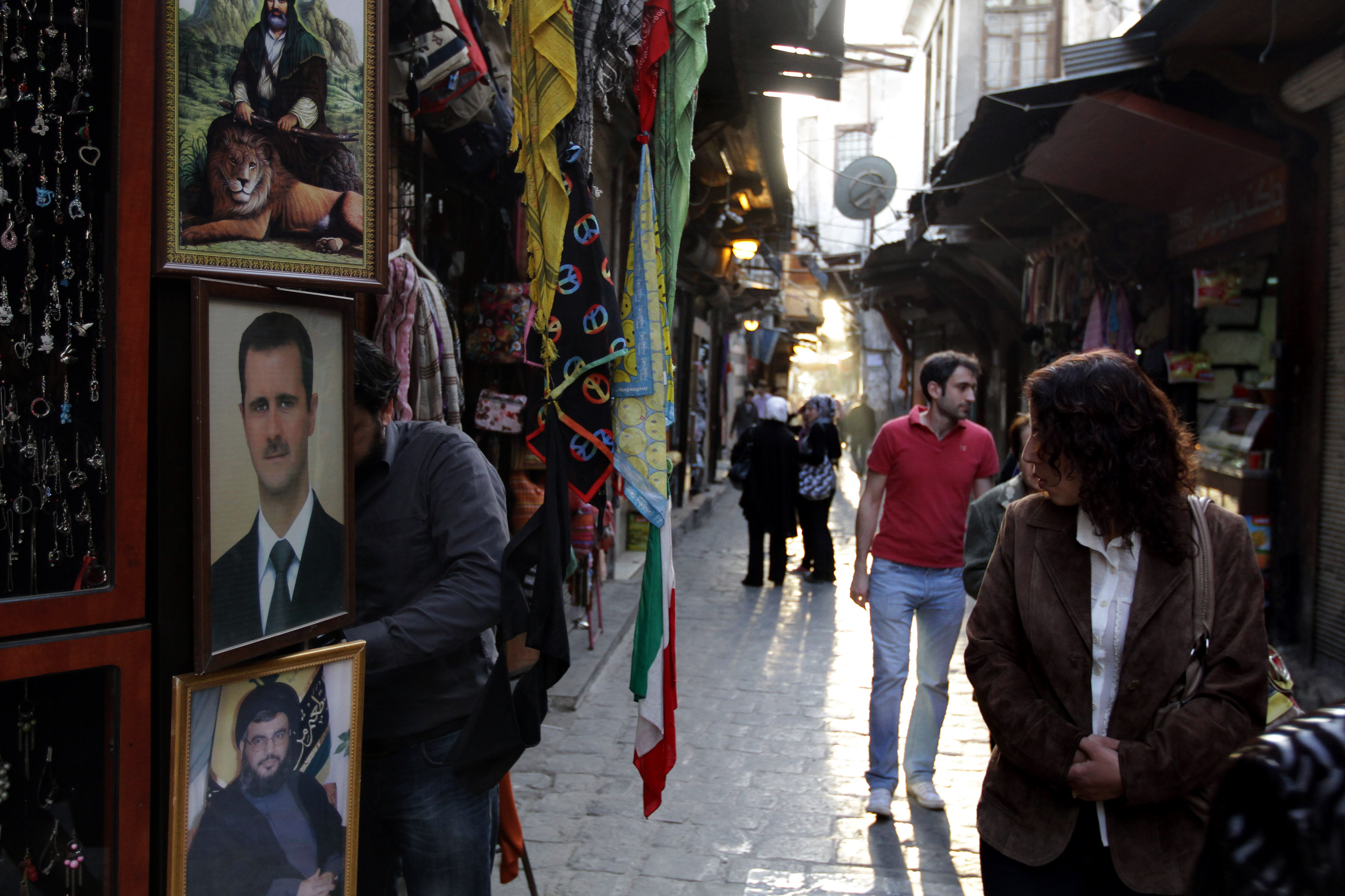 A picture of Syrian President Bashar al-Assad at the entrance of a store at a market in Damascus.
