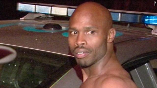 Accused cop killer surrenders after hostage standoff