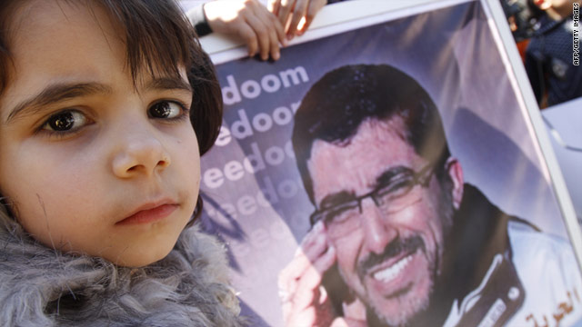 Palestinian relatives of Dirar Abu Sisi attend a Gaza demonstration calling for his release from an Israeli jail on Tuesday.