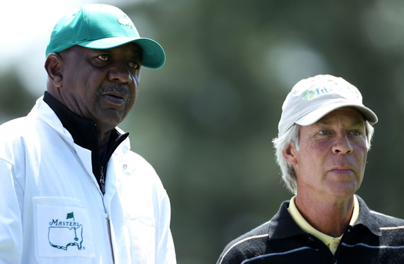 Carl Jackson (left) first became a caddy aged 11 and has been a staple on the Augusta course for the past 50 years.