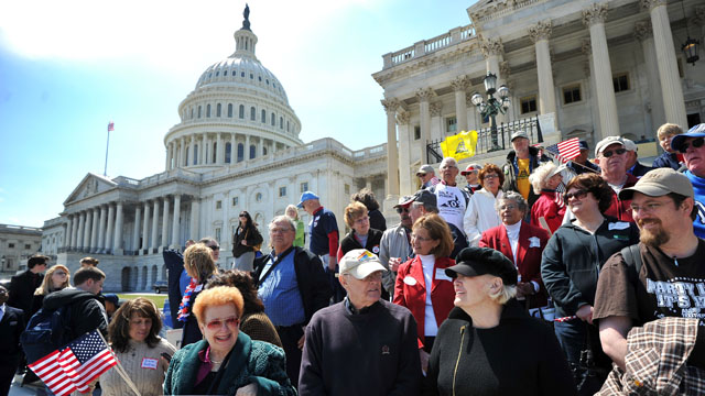 Protesters demonstrate in front of the U.S. Capitol on Thursday urging government spending cuts.