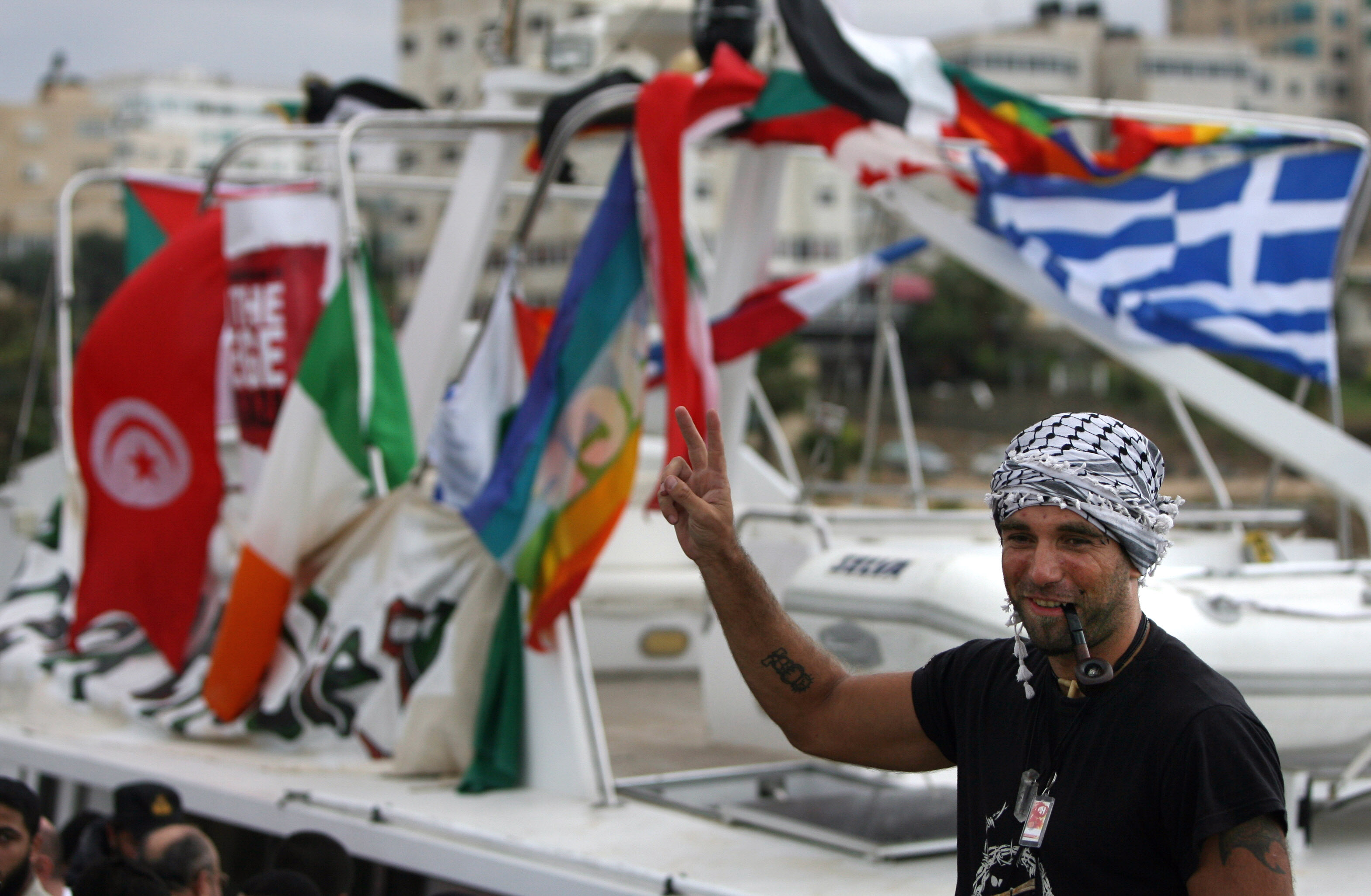 Vittorio Arrigoni at the port in Gaza City celebrating the arrival of the ship Dignity that departed from Cyprus to protest against the Israeli sanctions. A Salafist group of radical Islamists killed the Italian activist after kidnapping him in Gaza Getty Images AFP.