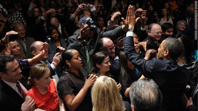 Singing woman interrupts Obama fundraiser