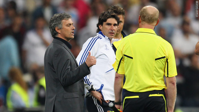 Mourinho gives an ironic thumbs up to officials after Pepe was sent off.