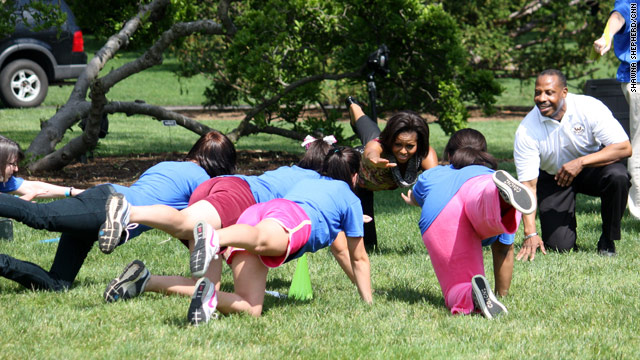 Michelle Obama flexes her muscles to help military families