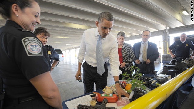Obama tours port facility steps from Mexico