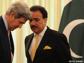 John Kerry listens to Pakistani Interior Minister Rehman Malik prior to a meeting with Pakistani Prime Minister Yousuf Raza Gilani in Islamabad.