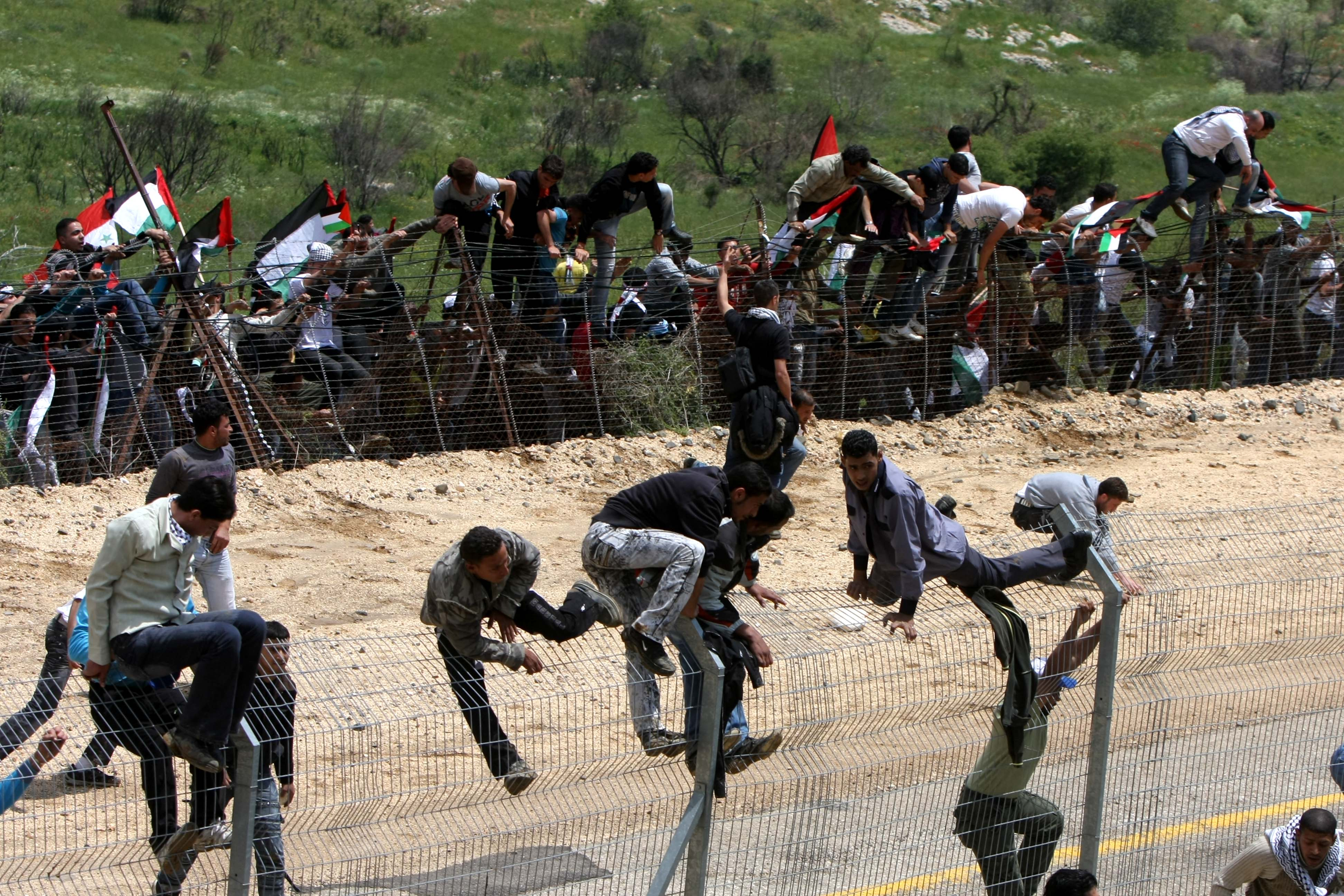 Palestinian protesters infiltrate the Israel-Syria border on May 15 near the Druze village of Majdal Shams. Reportedly at least twelve were killed and several injured when Israeli soldiers opened fire on protesters AFP/ Getty Images.