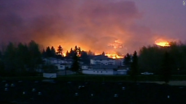 Town devastated, fires out of control in Alberta