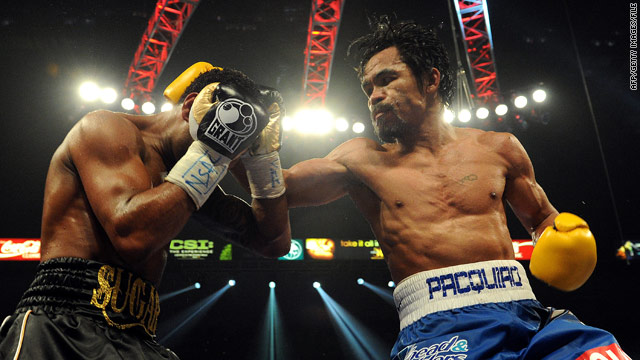 Manny Pacquiao laces up gloves in country's fight over birth control