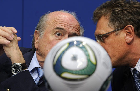 Sepp Blatter listens to FIFA general secretary Jerome Valcke during a press conference on May 9, 2011.