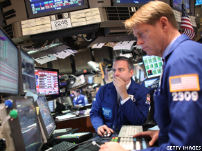 Traders work on the floor on the New York Stock Exchange.