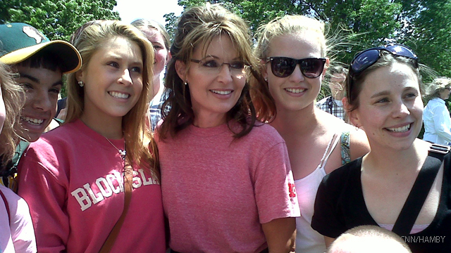 Palin attacks Romney's record on his announcement day