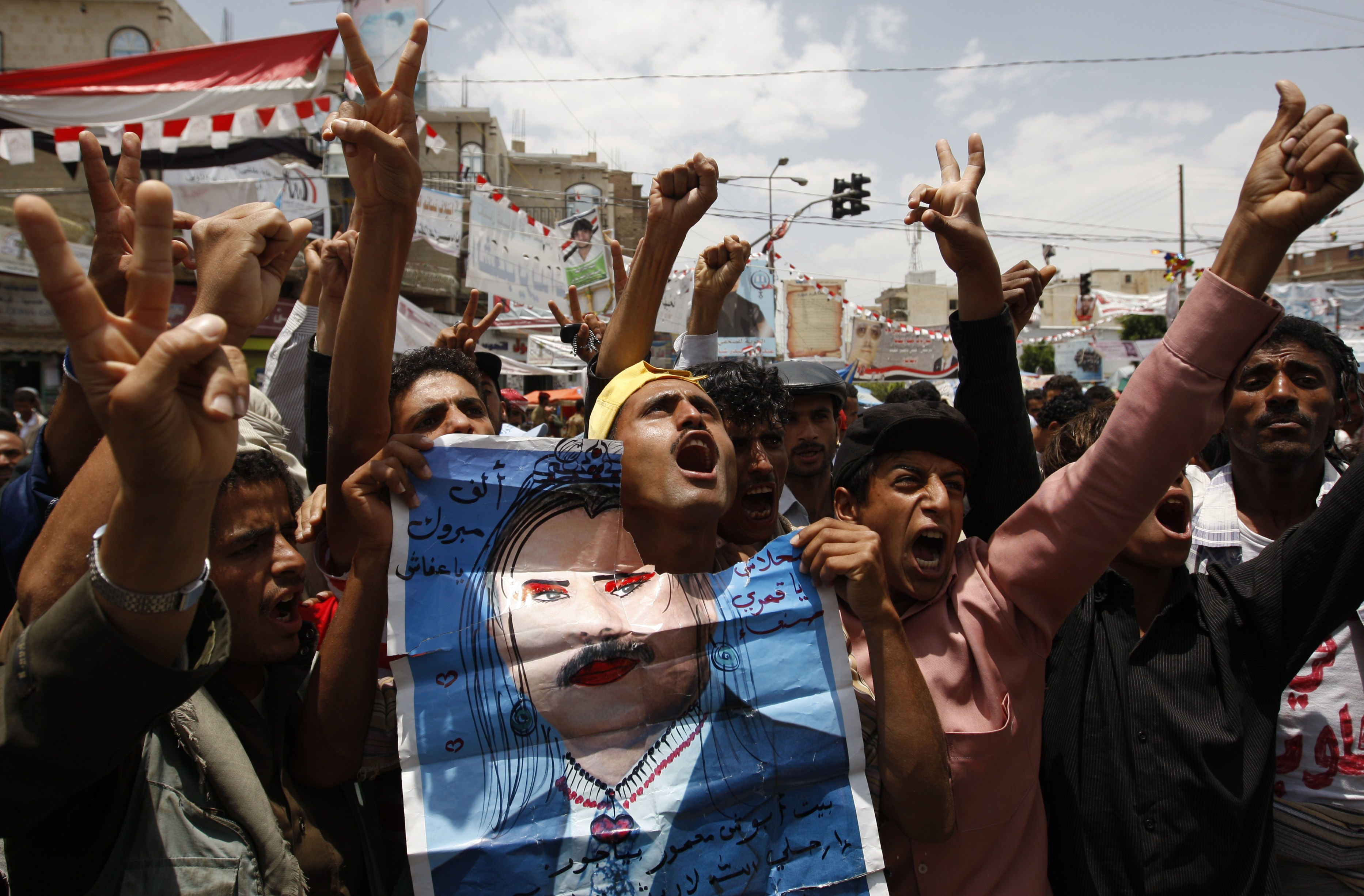 Yemeni anti-government protesters shout slogans during a demonstration calling for the ouster of President Ali Abdullah Saleh in Sanaa.