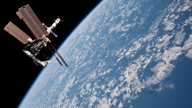 NASA shows first pics of shuttle docked to space station