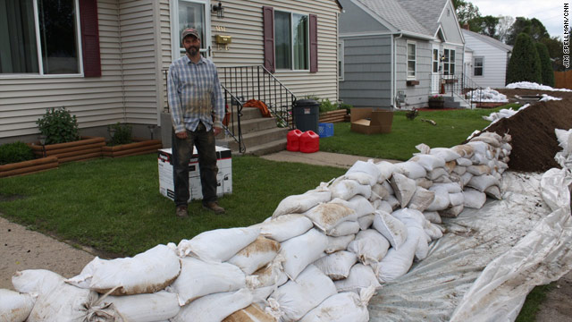 Water tops Minot, N.D., dikes as residents seem resigned to major flooding