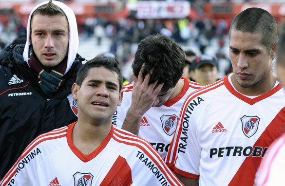 River&#039;s players stand dejected after their relegation was confirmed.