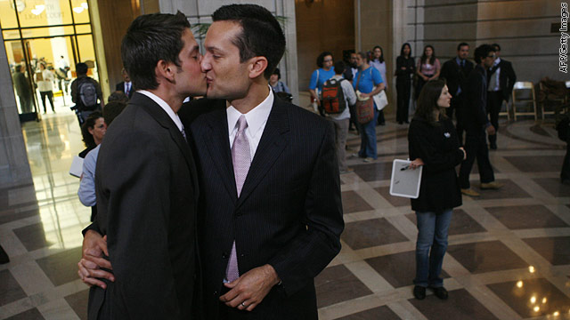 Spencer Jones,(L) and Tyler Barrick, kiss before exchanging marriage vows at ...