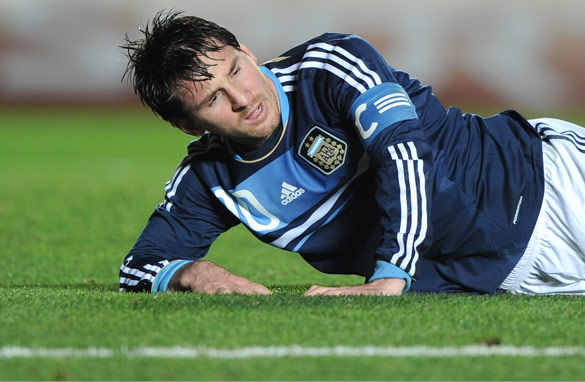 Down and out: Lionel Messi was powerless to prevent Argentina being eliminated by Uruguay.
