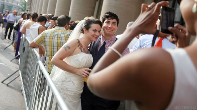 First New York couples wed under new same-sex marriage law