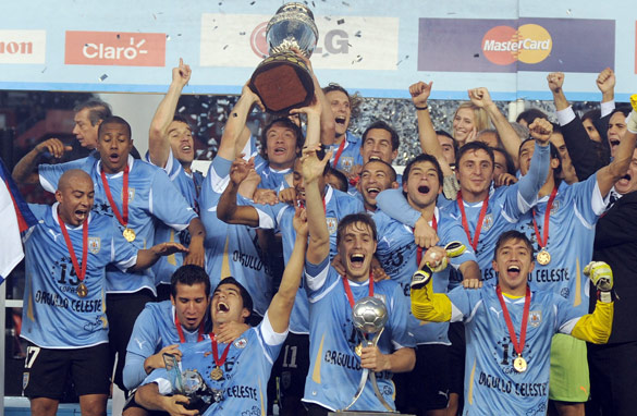 Uruguay's players celebrate after beating Paraguay 3-0 in the 2011 Copa America final.