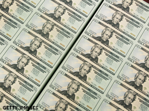 Sheets of freshly made $20 bills lay in stacks at the Bureau of Engraving and Printing.