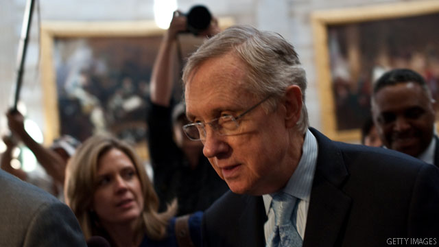 Reid backs debt agreement, pending caucus agreement