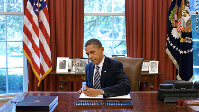 Obama signs debt ceiling bill, ends crisis