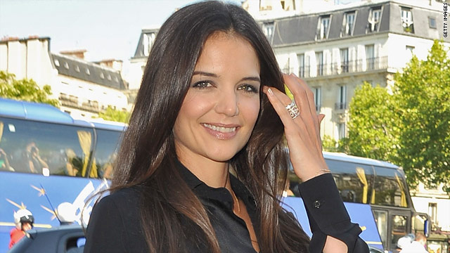 Katie Holmes scared off a raccoon... by barking