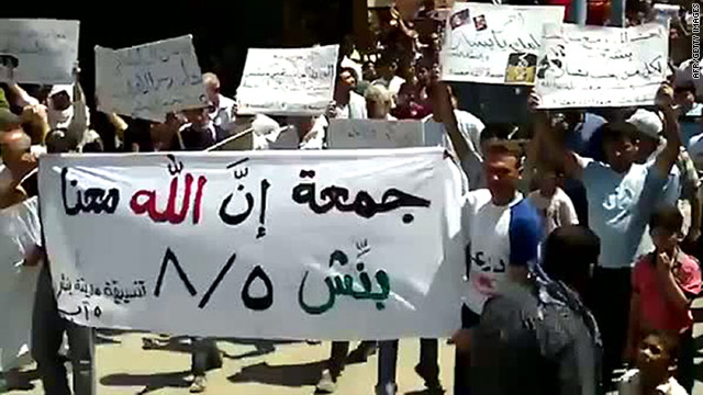 As Syria seethes, protesters chant 'God is With Us'