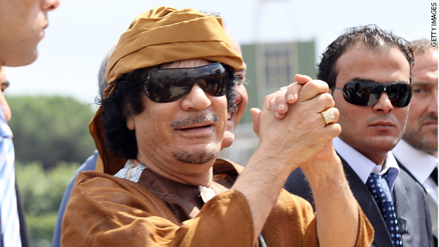 What should happen to Libya's Gadhafi if captured?