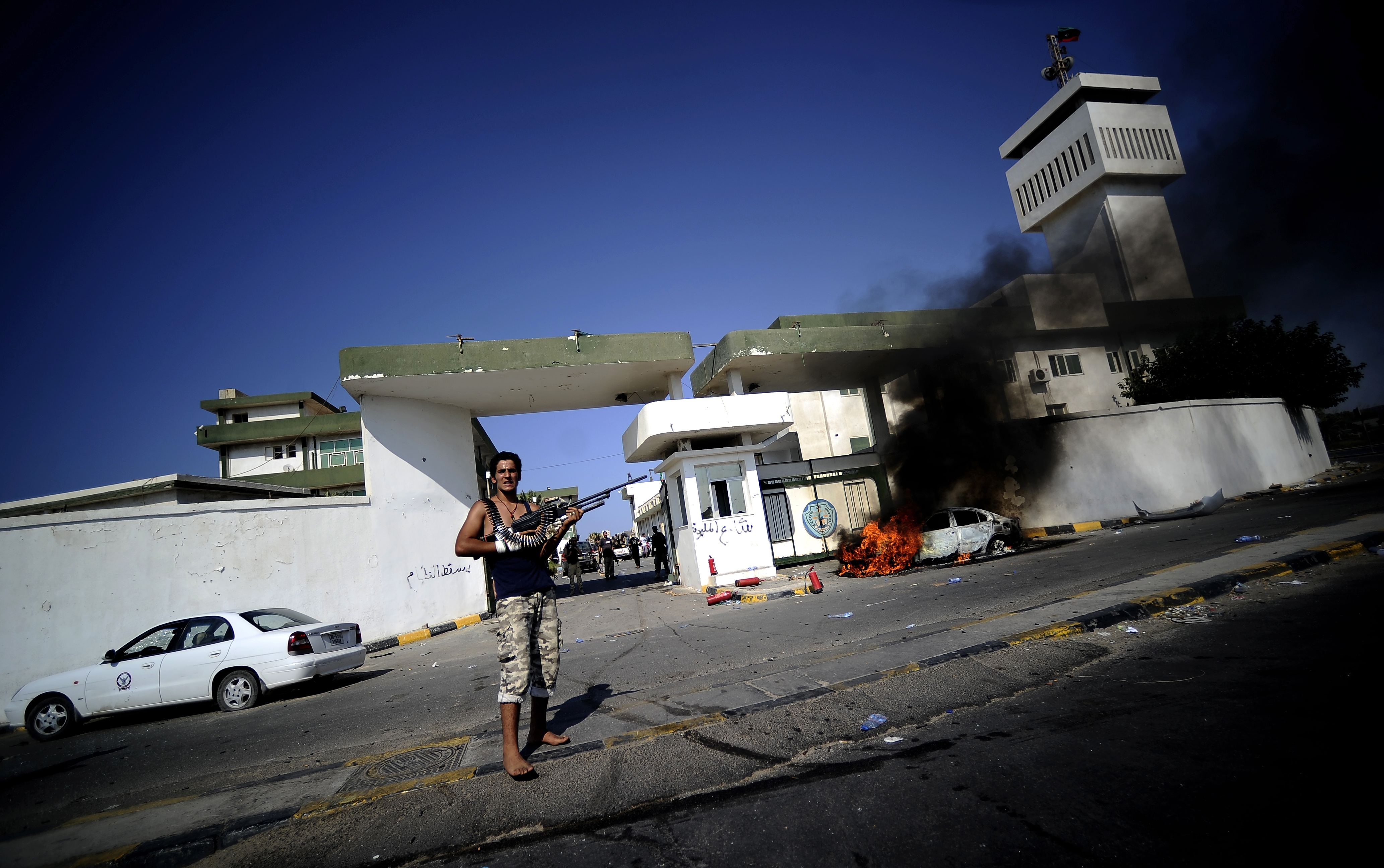 Need to Know News: Rebels launch siege on Gadhafi compound as residents flee Tripoli