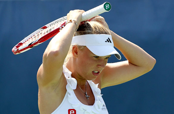 Caroline Wozniacki has reached the top of tennis' world rankings despite not winning a grand slam title.
