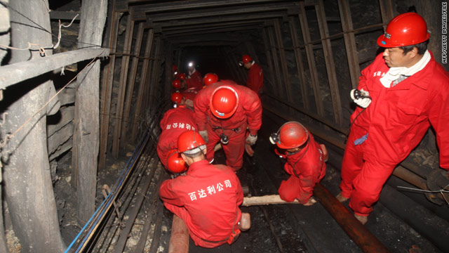 Rescuers in China hear 'knocking' as they scramble to save 22 coal miners