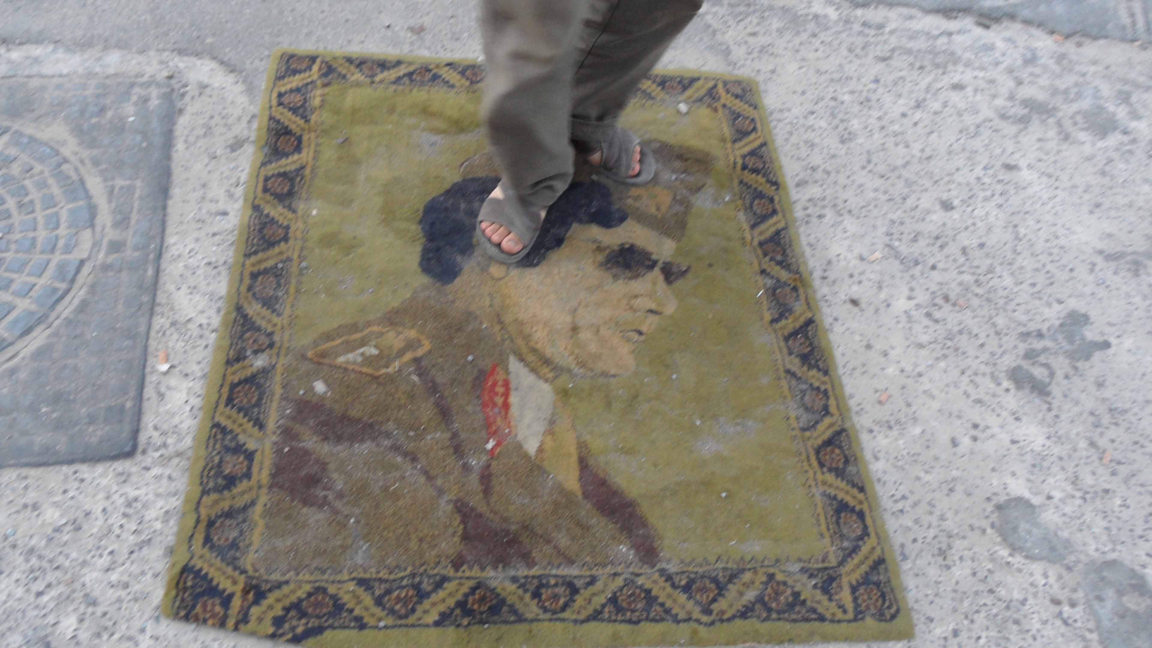 Stepping on Gadhafi's face