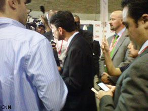 A guest producer's view of the post-debate response. Here, Louisiana Gov. Bobby Jindal is talking with reporters.
